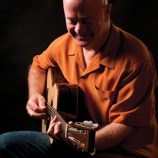 Mark Cosgrove plays guitar