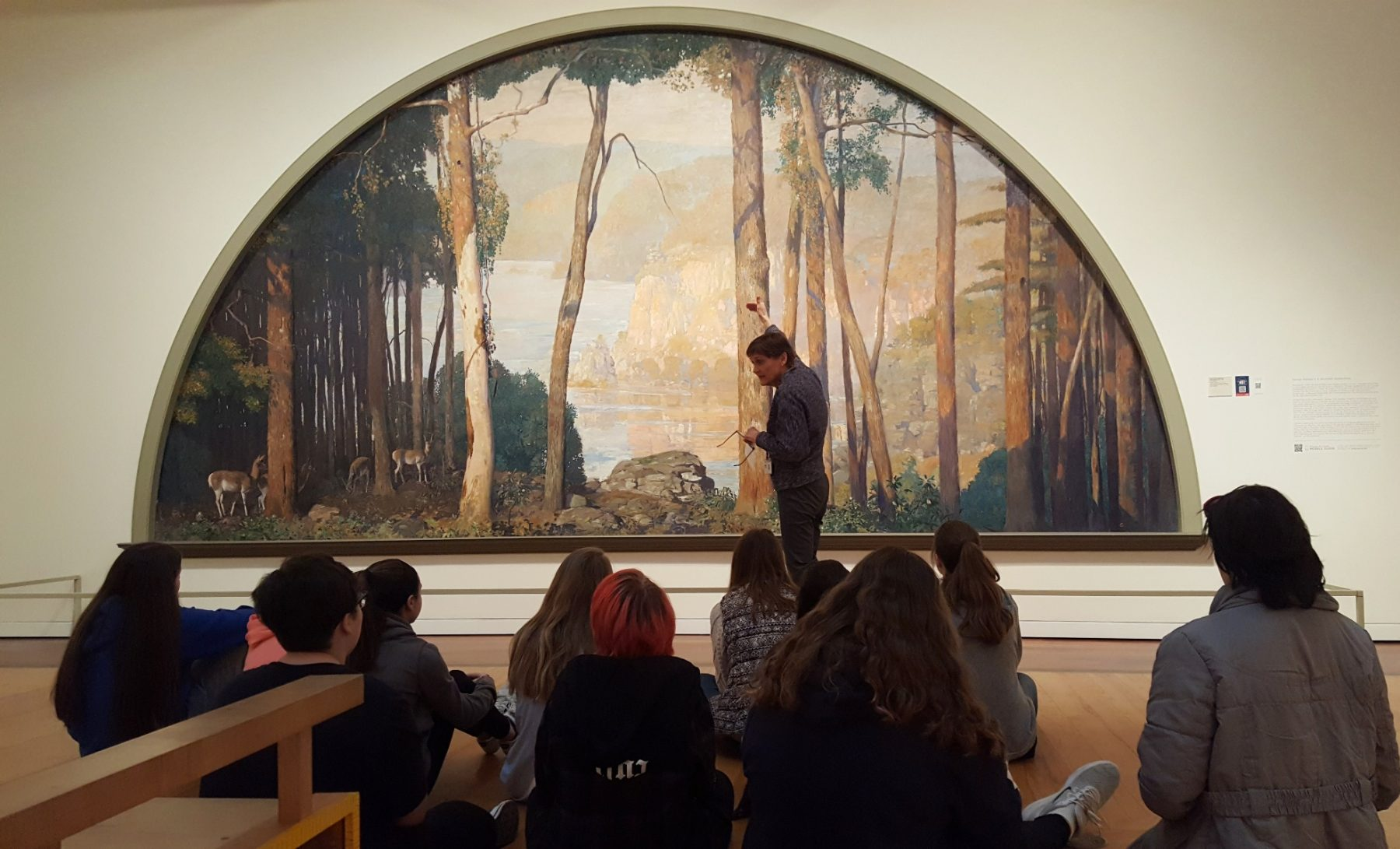 students examine Daniel Garber's A Wooded Watershed mural